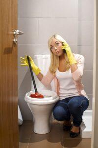 plunger-woman-call-plumber