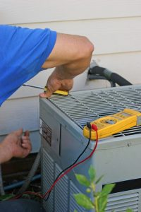 central ac system being worked on by a technician